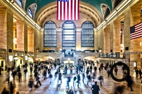 Travelers rush through the Main Concourse of Grand Central Terminal, New York City.