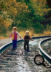 My niece and nephew on railroad tracks near Russell, Ky., October 1978.