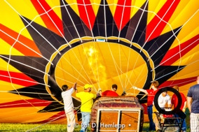 A crew inflates the canopy of a hot-air balloon during a festival in Grove City, Ohio.